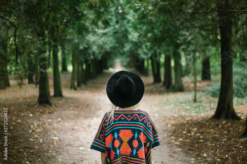 Woman standing in green alley