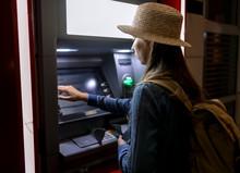 Woman Using ATM On Street
