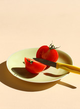 Sharp Knife And Sliced Tomato ...