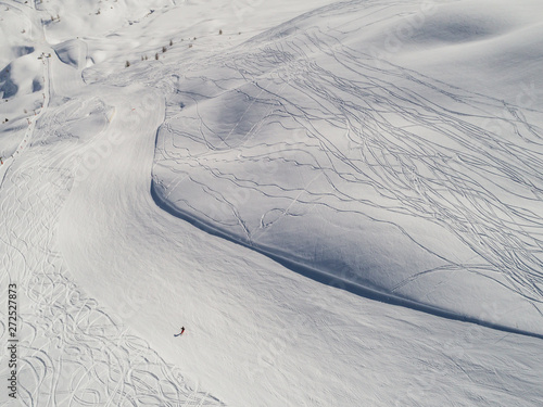 People skiing on the mountain aerial view