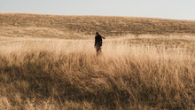 Wide Shot Of A Woman In The Prairie