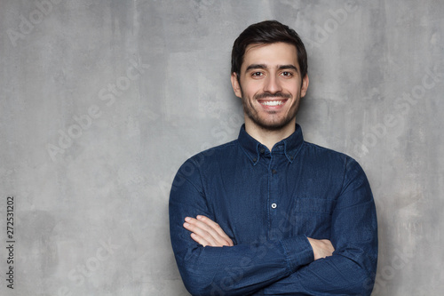 Fotomural  Portrait of young European male in denim shirt looking at camera with confident