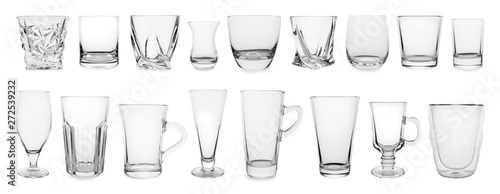 Photo  Set of different empty glasses on white background