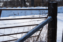 Wooden Fence Post And Wire And...