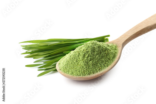 Obraz na płótnie Wheat grass powder in wooden spoon and sprouts on white background