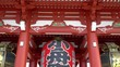 Tilt down from the red wooden roof to the huge lantern at the gate of the Asakusa Temple, Toyko.