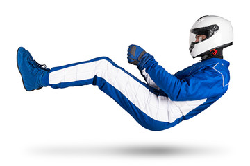 Race driver in blue white motorsport overall hover over ground in driving seat position with shoes gloves and safety crash helmet, isolated white abstract racing background.