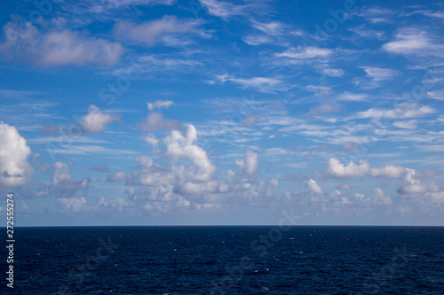 White fluffy clouds with a beautiful blue sky over the ocean