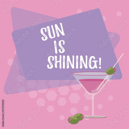 Photo Stands Candy pink Text sign showing Sun Is Shining. Conceptual photo Beautiful sunshine Enjoying hot summer days Natural landscape Filled Cocktail Wine Glass with Olive on the Rim Blank Color Text Space