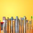 Leinwandbild Motiv Row of artist paint brushes  on background