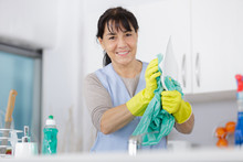 Mature Woman With Gloves Washi...