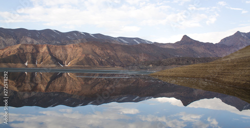 Poster Marron chocolat The beautiful mountains landscape with lake and reflection.