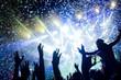 Leinwandbild Motiv Portrait of happy crowd enjoying at music festival