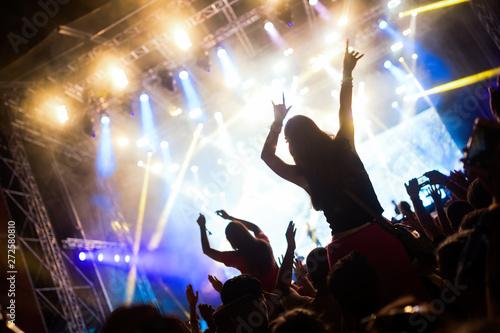 Portrait of happy crowd enjoying at music festival - 272580810