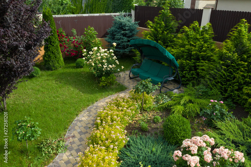 Staande foto Tuin Garden with walkways and green grass. Photo taken from above drone.