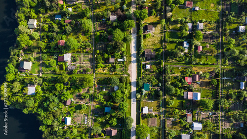 Tiny Ecological Friendly City Plot Gardens on Lake Edge, Aerial Top Down View Canvas Print