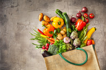Vegetables Overflowing From Fallen Grocery Bag