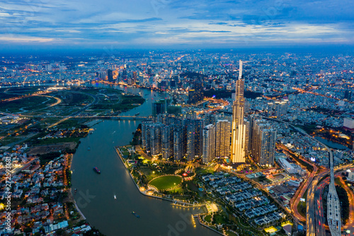 Top View of Building in a City - Aerial view Skyscrapers flying by drone of Ho Chi Mi City with development buildings, transportation, energy power infrastructure Wallpaper Mural