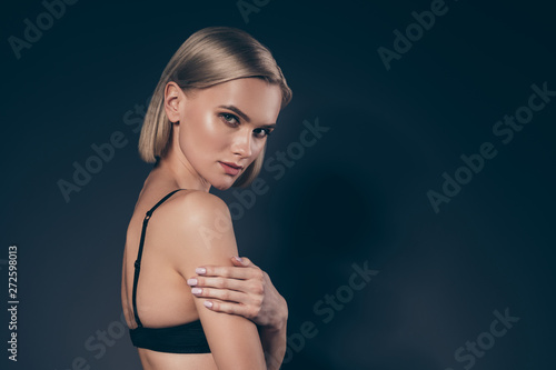 Close up side profile view photo beautiful she her lady cunning satisfaction pleasure mistress hold hand arm shoulder dark silky bra tenderness skinny slim shape isolated black grey background - 272598013