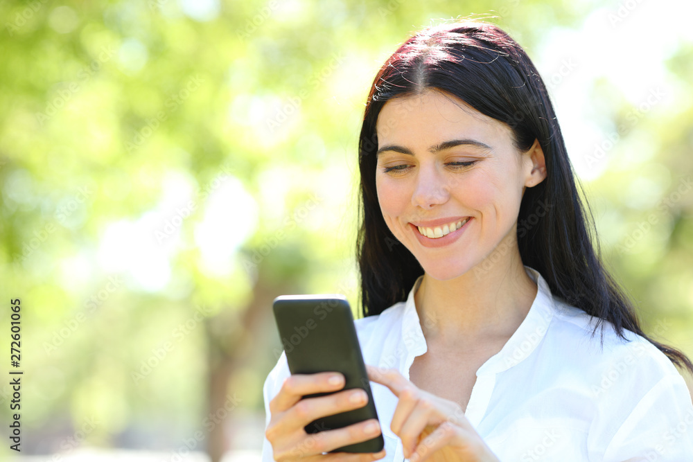 Fototapety, obrazy: Happy beauty woman using phone in a park