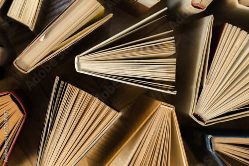 Old and used hardback books, text books seen from above on woode Tablou Canvas
