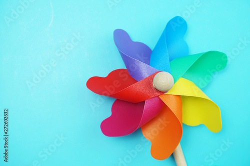 Fotografie, Tablou  colorful pinwheel with space copy isolated on blue background