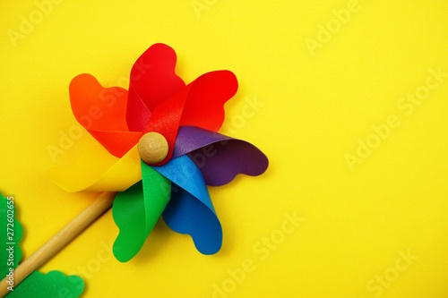Fotografia, Obraz  colorful pinwheel with space copy isolated on yellow background
