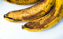 Top View Of Brown Spotted Bananas. Banana With Dark Black Spots