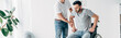 Leinwandbild Motiv panoramic shot of Physiotherapist helping handicapped man during recovery