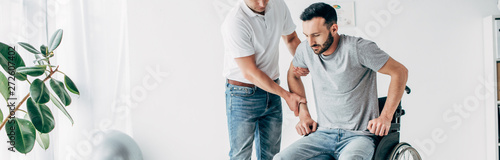 mata magnetyczna panoramic shot of Physiotherapist helping handicapped man during recovery