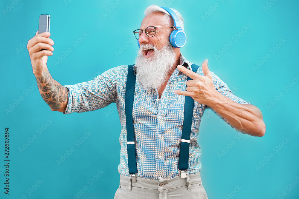 Fototapety, obrazy: Senior hipster man using smartphone app for creating playlist with rock music - Trendy tattoo guy having fun with mobile phone technology - Tech and joyful elderly lifestyle concept - Focus on face