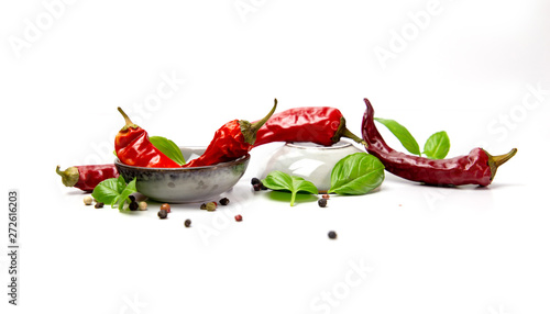 chilli pepper and basil leaves still life isolated on white backgroun