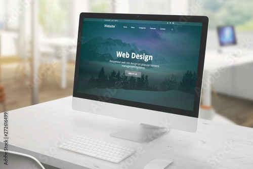 Studio monitor with web design studio presentation. White desk with keyboard and mouse. Office in background. - 272616499