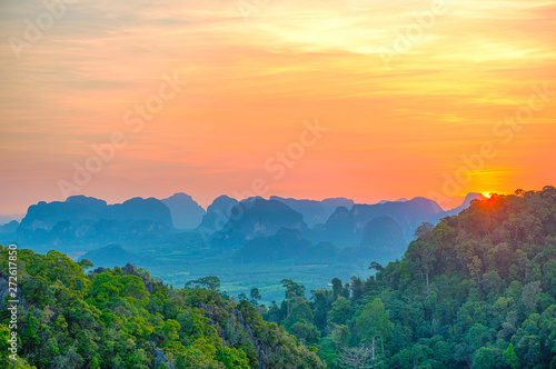 Foto auf Gartenposter Blau Jeans Majestic landscape with dramatic sunset and silhouette of steep mountain ridge on horizon. HDR image