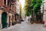 Fototapeta Uliczki - Old street of the historic city center of Antwerpen (Antwerp), Belgium. Cozy cityscape of Antwerp. Architecture and landmark of Antwerpen