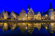 canvas print picture - View of Graslei quay and Leie river in the historic city center in Ghent (Gent), Belgium. Architecture and landmark of Ghent. Night cityscape of Ghent.