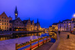 canvas print picture - View of Graslei, Korenlei quays and Leie river in the historic city center in Ghent (Gent), Belgium. Architecture and landmark of Ghent. Sunset cityscape of Ghent.