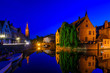 canvas print picture - Classic view of the historic city center of Bruges (Brugge), West Flanders province, Belgium. Night cityscape of Bruges.