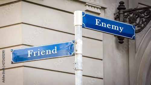 Cuadros en Lienzo Street Sign to Friend versus Enemy