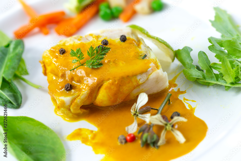 Fototapeta Plate of Steamed fish with curry sauce with salad