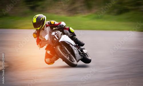 Fotografie, Obraz Motorcycle racing on asphalt track.