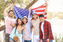 Young People With USA Flag Outdoors. Independence Day Celebration