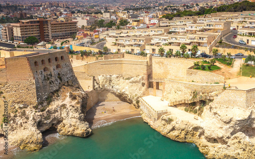 City walls with beach in Melilla, Spanish province in Morocco.