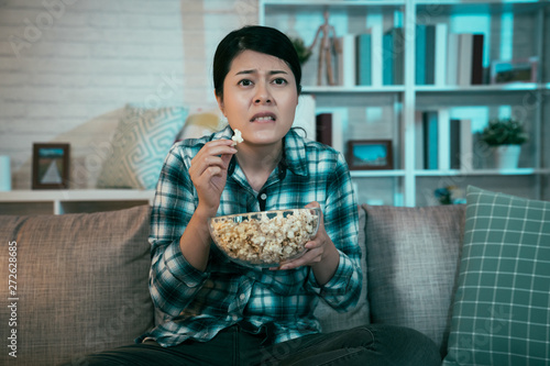 Pleasant Nervous Asian Woman Spectator Watching Tv At Home In Night Download Free Architecture Designs Scobabritishbridgeorg
