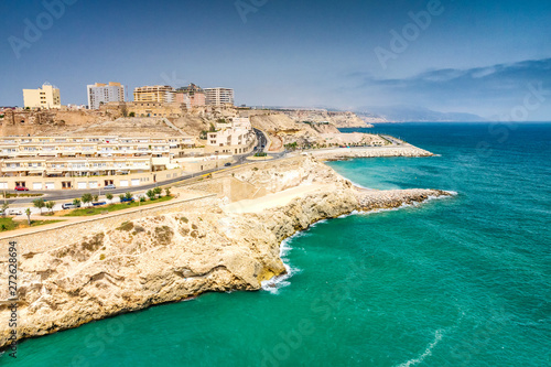 City walls on the rocky Mediterranean coast in Melilla, Spanish province in Morocco.