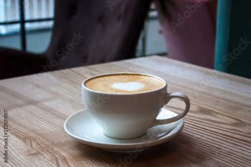 Photo White cup of cappuccino.