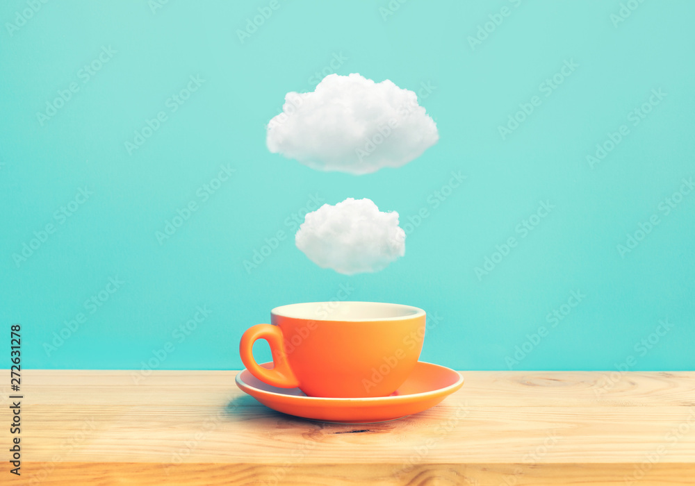 Fototapeta Inspiration creativity concepts with a cup of coffee on wood bar table with some cloud on blue sky color background