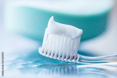 Stampa su Tela Plastic toothbrush with white toothpaste on a blue table