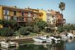 Colorful houses and boats at Saplaya Port Alboraya Valencia Spain