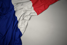 Waving National Flag Of France On A Gray Background.